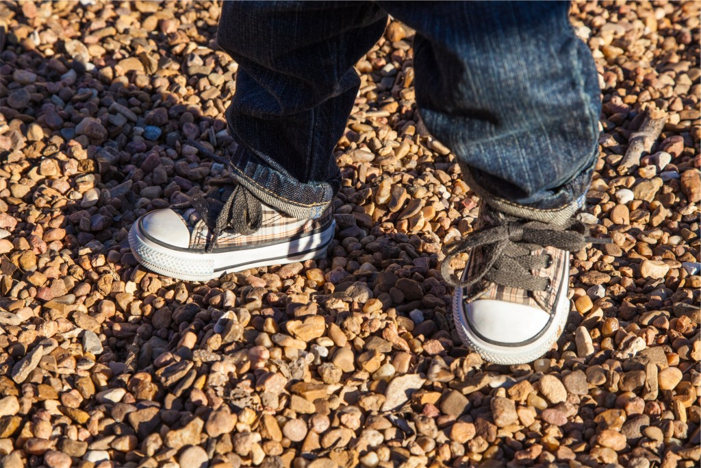 child's feet in playground